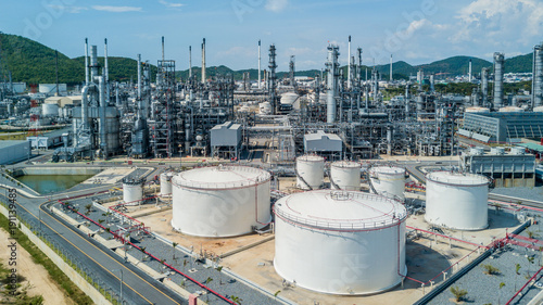 Fototapeta Aerial view oil refiner industry, White storage tank in refinery plant, Oil and Gads refinery factory. obraz