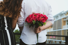 Man Holding Bouquet Of Red Ros...