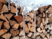 Icicles And Firewood In The Ba...