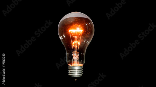 Pinturas sobre lienzo  Light bulb on a black background