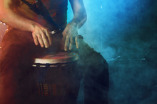 The Musician Plays The Bongo On Stage.