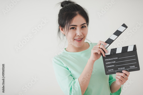 Young Asian woman playing clapperboard with positive emotion Canvas Print