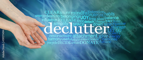 Photo  Angelic feather Declutter Word Cloud - female cupped hands offering the word DEC