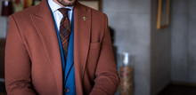 Man In Custom Tailored Suit An...