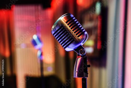 Fotografie, Obraz  Retro microphone on stage in a pub