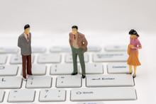 Mini People On A Computer Keyb...