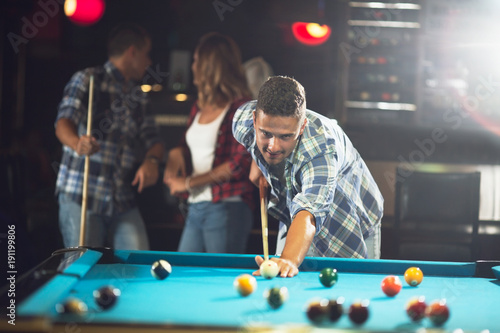 Fotografie, Obraz  Pool  player ready for the shot