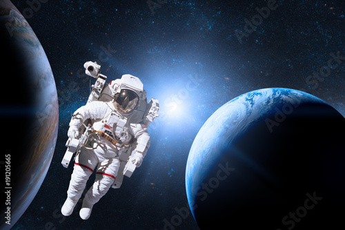 Deurstickers Nasa Astronaut in outer space on background of the planet. Elements of this image furnished by NASA.