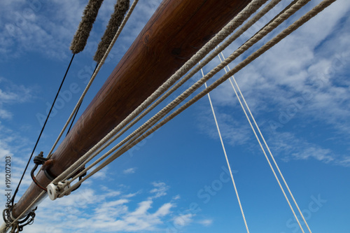 Fotografie, Obraz  Sailboat Mast  and ropes with cloudy blue sky in the background