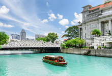 Scenic View Of Tourist Boat Sailing Along The Singapore River