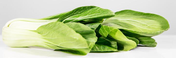 Panel Szklany Podświetlane Warzywa frischer Pak Choi oder Pak Choy vor Weiß