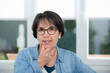 canvas print picture - portrait of middle age brunette with glasses