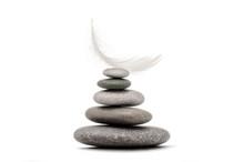 Stone Balance With Plume. Spa Stones Isolated On White Background.