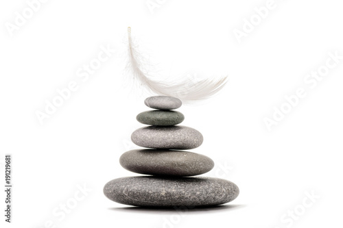 Poster Spa Stone balance with plume. Spa stones isolated on white background.