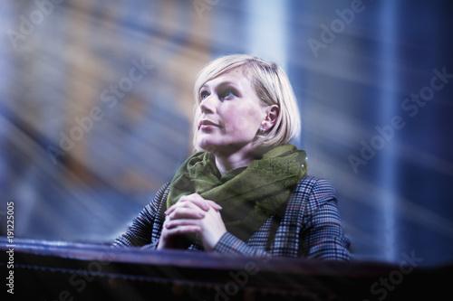 Portrait of a beautiful woman praying in churches. Fototapeta