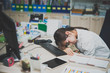 Businesswomanman stress from hard work on the desk at office dark tone,thailand people