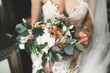 canvas print picture - Bride holding big and beautiful wedding bouquet with flowers