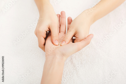 Hand massage closeup, acupressure Canvas Print