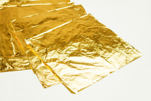 Pile Of Square Gold Leaf On White Background