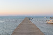 Wood bridge pier against beautiful sunset sky