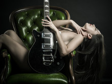 Sexy Woman Posing With Electric Guitar