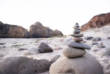 Stack Of Pebbles At Beach Against Clear Sky