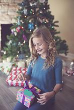 Girl Holding Christmas Present...