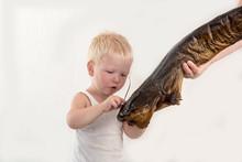 The Little Boy Shows What A Bi...