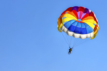 Two Men Are Gliding Using A Pa...