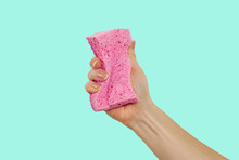 Woman's Hand, Holding A Sponge For Dishes