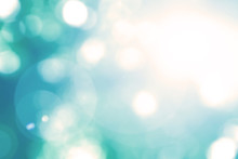 Blurred Sky Background With Nature Glowing Sun Light Flare And Bokeh In Vintage Blue