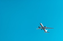 Big White Plane Flying In A Blue Sky