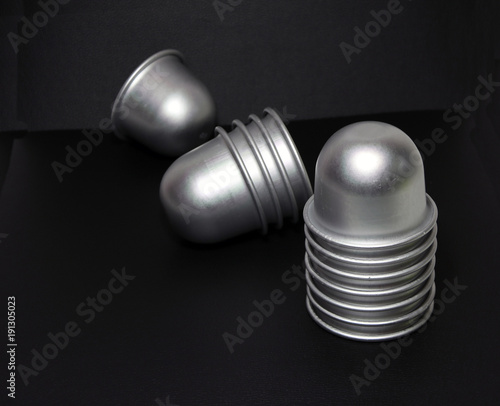 Round mold, Aluminum cup for baking on a black background