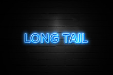 Long Tail Neon Sign On Brickwall