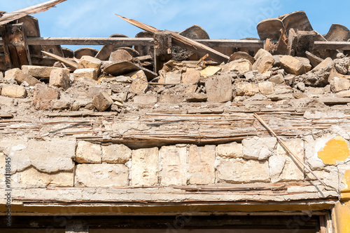 Fotografie, Obraz  Small old and abandoned house roof demolished by the earthquake destruction clos