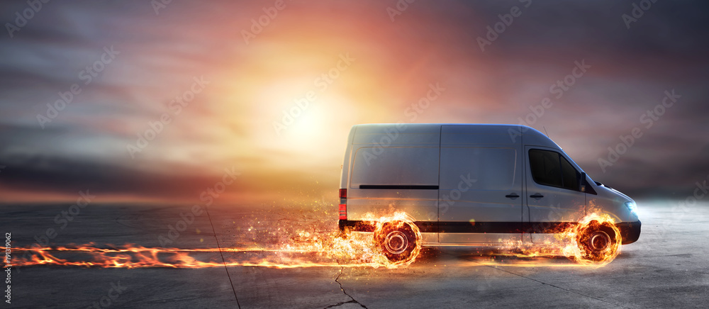 Fototapeta Super fast delivery of package service with van with wheels on fire