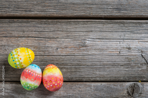 Easter painted eggs on a wooden Canvas Print