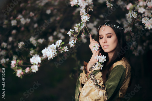 Beautiful Spring Fairy Princess Next to Blooming Tree