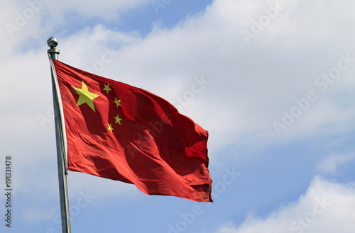 Tuinposter China Chinese flag waving in the wind on a sunny day