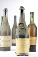 Group Of Old Dusty Bottles Of ...