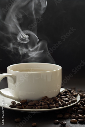 Fototapety, obrazy: Hot cup of coffee with smoke on black background