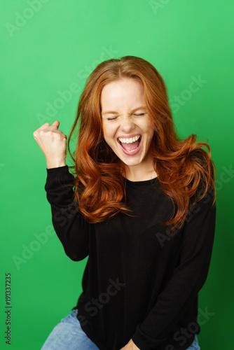 Fotografía  Jubilant excited young woman cheering