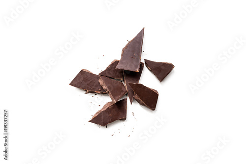 dark chocolate pieces isolated on white background. Horizontal composition. Top view