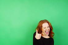 Cheerful Woman Giving Thumb Up On Green Background