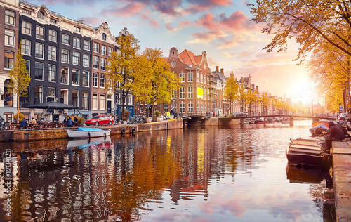 Photo Stands Autumn Channel in Amsterdam Netherlands houses river Amstel landmark