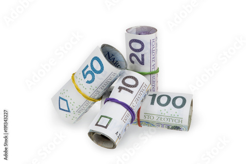 Fotografía  Pile of rolls of polish zloty banknotes of various denominations tied with rubber bands isolated on white background with clipping path