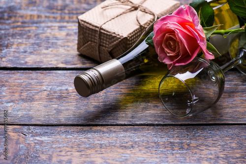 White wine bottle wine glass present box and flowers roses on white wine bottle wine glass present box and flowers roses on wooden background mightylinksfo