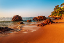 Sandy Beach And Large Boulders...