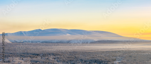 Winter orange sunrise over the Khibiny mountains Wallpaper Mural