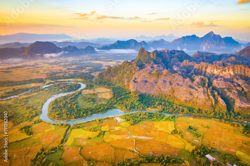 Poster Luchtfoto Aerial view of the fields, river and mountain. Beautiful landscape. Laos.